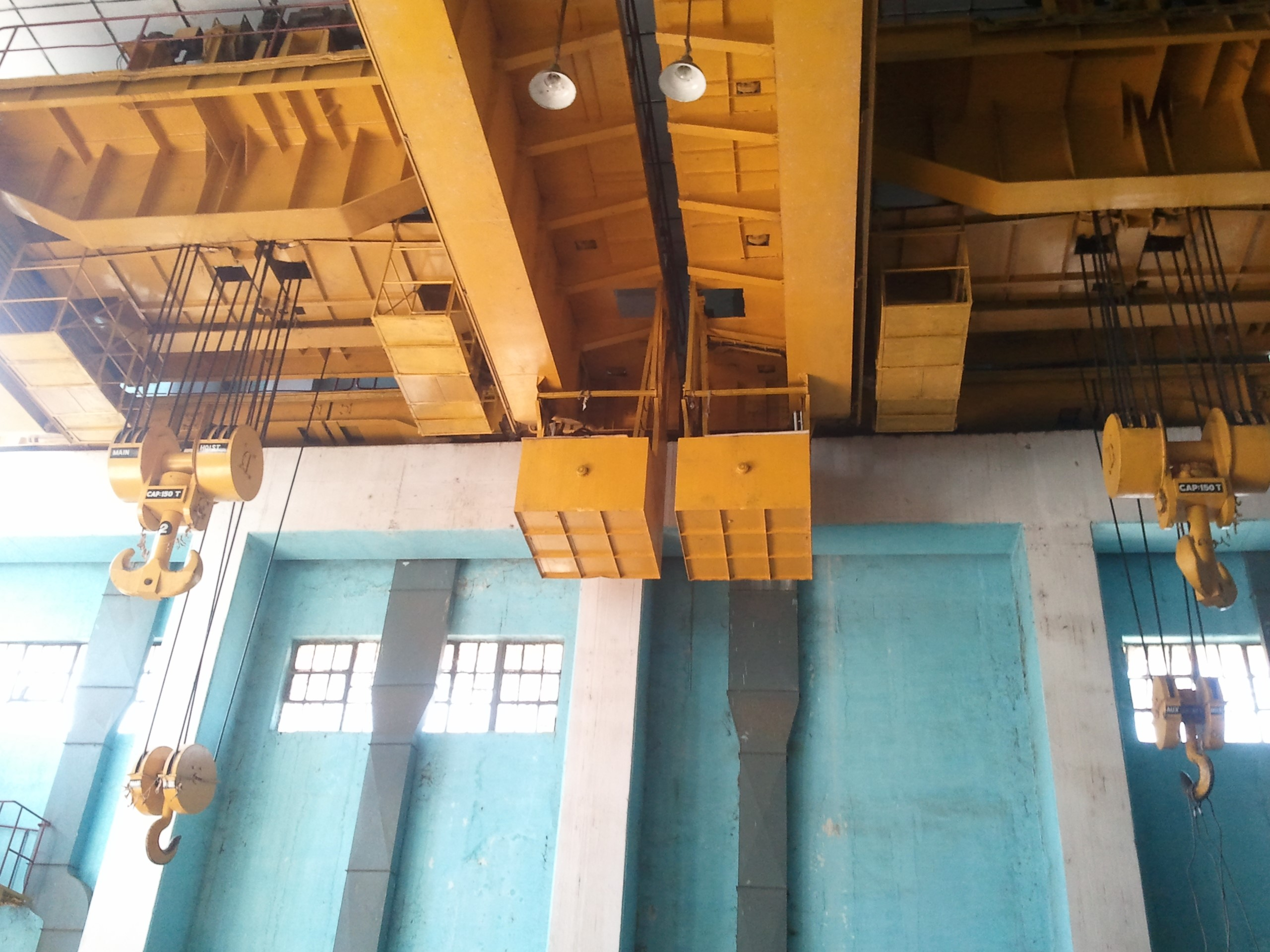 Complete Overhauling and repairing of 150/30 Tons EOT Cranes 02 Nos., including supply/ replacement required spares at Hydro Power Station, Uka